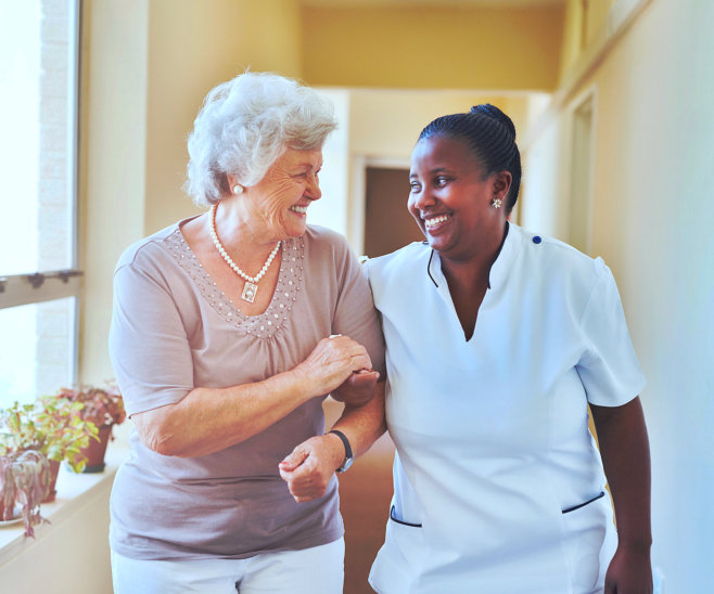 nurse and elderly woman walking