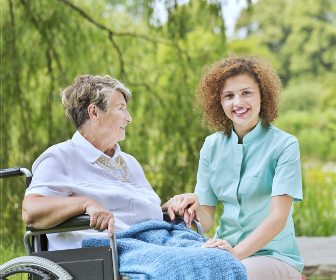 nurse and elderly woman smiling